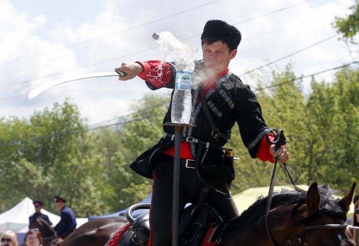 ROSTOV-ON-DON REGION, RUSSIA - MAY 4, 2019: Trick riders compete at the Shermitsii International Cossack Games marking the centenary of the Vyoshenskaya Uprising during the Russian Civil War. Shermitsii is a traditional Don Cossack horse riding, sword and fist fighting competition. Valery Matytsin/TASS (Photo by Valery MatytsinTASS via Getty Images)