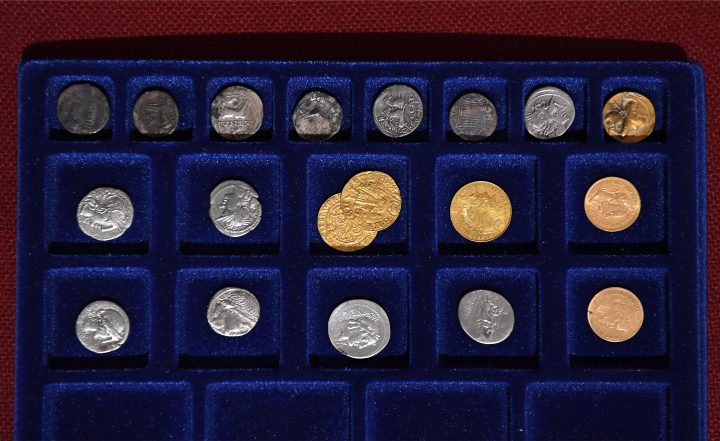 Gold, silver and other metal coins of a Holocaust victim's collection are seen on a velvet tray in the Balatoni Museum in the town of Keszthely, 200 km west of Budapest on May 22, 2019. - A collection of thousands of antique coins found buried in a house that was part of a war-time ghetto in Hungary for Jews has posed a riddle for historians. (Photo by ATTILA KISBENEDEK / AFP) / TO GO WITH AFP STORY (Photo credit should read ATTILA KISBENEDEK/AFP/Getty Images)