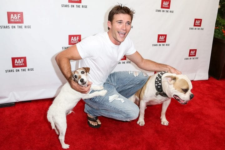 "LOS ANGELES, CA - JULY 11: Actor Scott Eastwood and actor dogs Uggie (L) and Popeye attend Abercrombie & Fitch's ""Stars on the Rise"" event at Abercrombie & Fitch on July 11, 2013 in Los Angeles, California. (Photo by Chelsea Lauren/WireImage)"