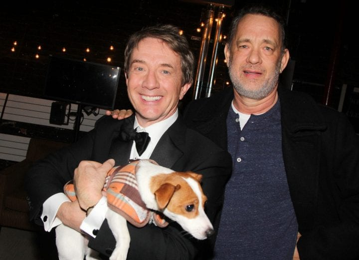 "NEW YORK, NY - JANUARY 07: (EXCLUSIVE COVERAGE) Martin Short and Tom Hanks pose with ""Grace"" the dog backstage at the hit play ""It's Only A Play"" on Broadway at The Schoenfeld Theater on January 7, 2015 in New York City. (Photo by Bruce Glikas/FilmMagic)"