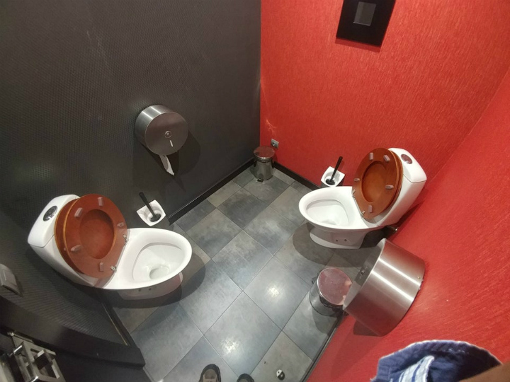 toilets facing each other