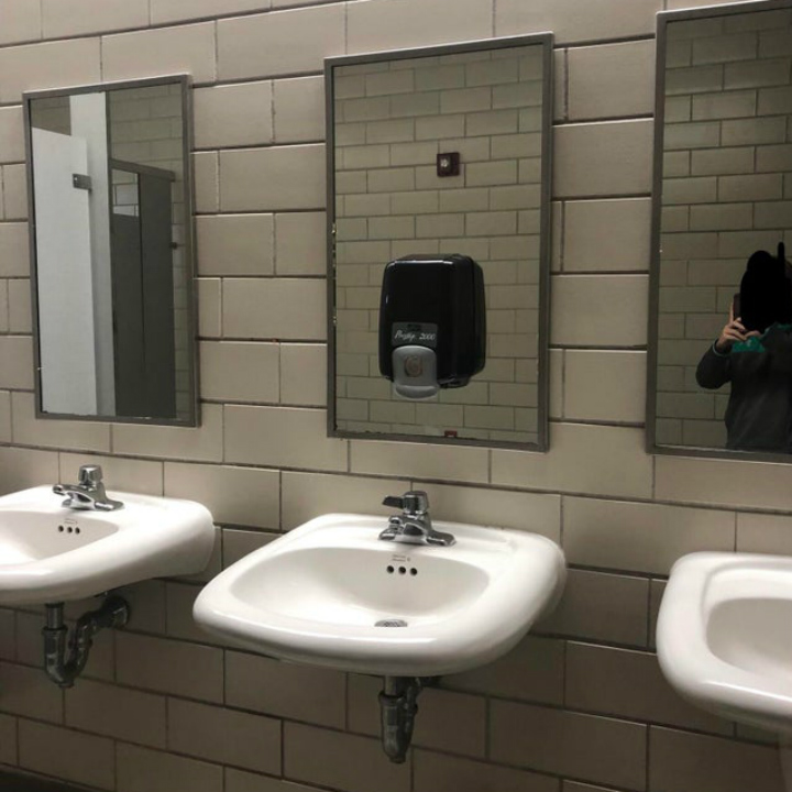 soap dispenser on mirror