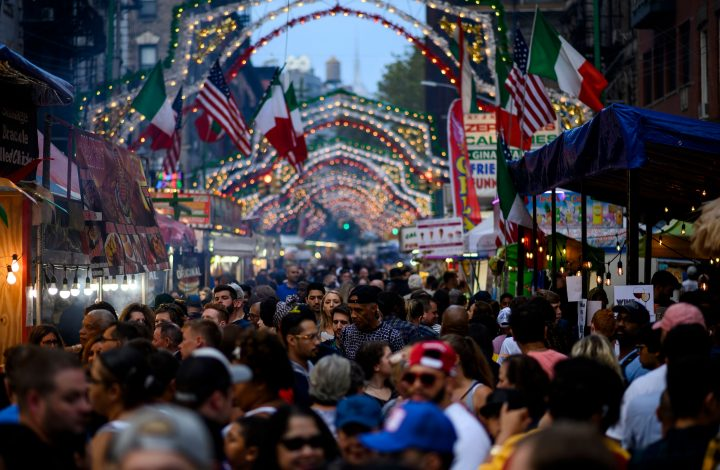 People walk down Mulberry Street during the Feast of the San Gennero in Little Italy in Lower Manhattan on September 14, 2019 in New York City. (Photo by Johannes EISELE / AFP) (Photo credit should read JOHANNES EISELE/AFP via Getty Images)