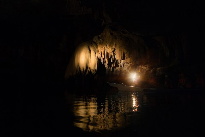 Unique inside view of Puerto Princesa subterranean underground river - Adventurous trip excursion in exclusive Philippines destination - Adventure travel concept to one new seven wonders of nature