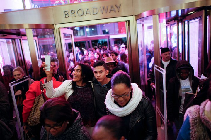 Customers stream into Macy's flagship store in Herald Square on Thanksgiving evening for early Black Friday