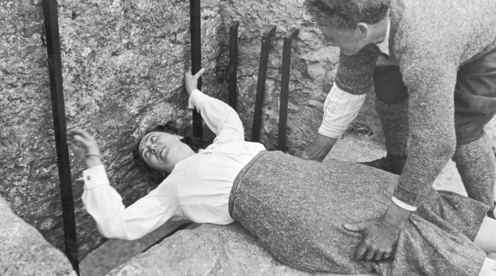 A women seen here with the aid of her gentleman friend kissing the Blarney stone at Blarney Castle. 22 August 1935 (Photo by Daily Mirror/Mirrorpix/Mirrorpix via Getty Images)