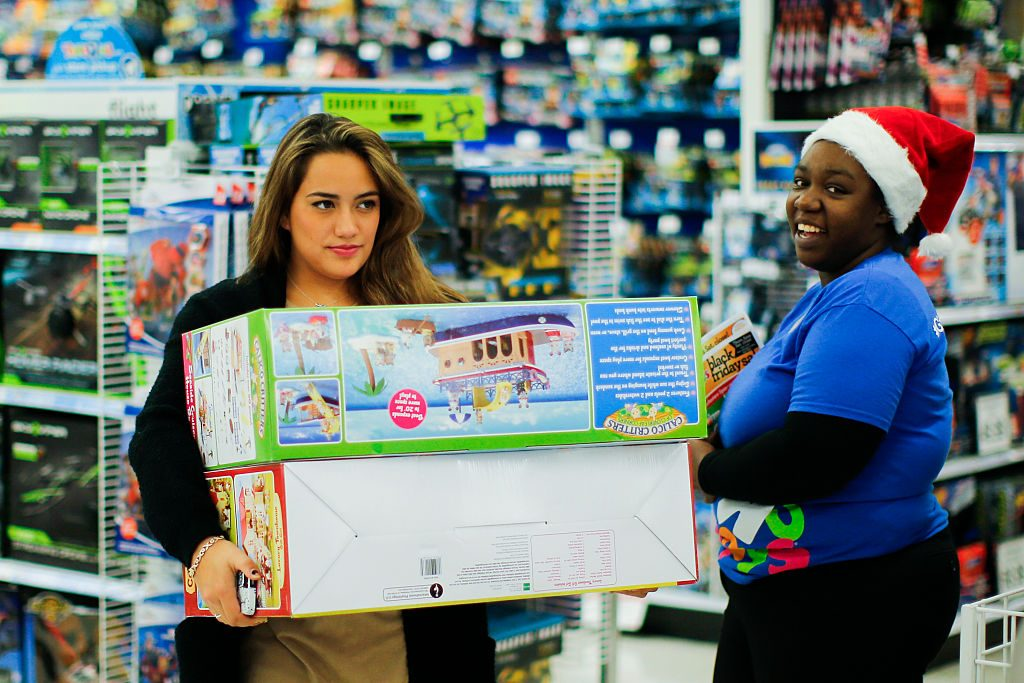 A woman shopping for toys at Wal Mart on Black Friday