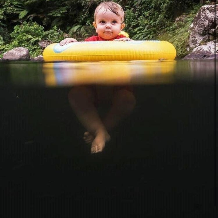 baby above the black, scary water