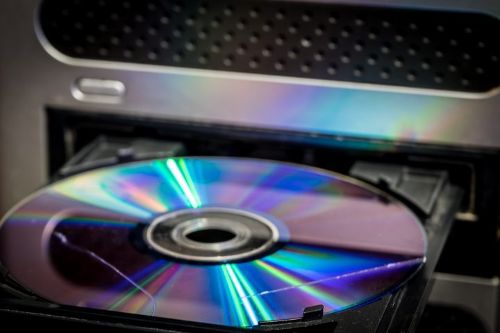 a CD with a scratch. CD in the computer drive. a CD with a scratch. CD in the computer drive.