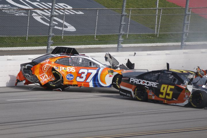 TALLADEGA, AL - APRIL 28: Chris Buescher, JTG Daugherty Racing, Chevrolet Camaro Tide Pods (37) Matt DiBenedetto, Leavine Family Racing, Toyota Camry Procore (95) wrecks during the running of the GEICO 500 on Sunday April 28, 2019 at Talladega Superspeedway in Talladega, Alabama (Photo by Jeff Robinson/Icon Sportswire via Getty Images)