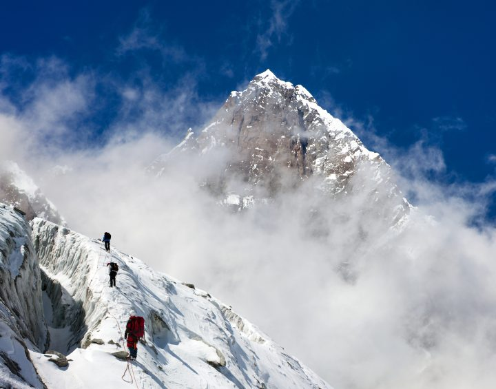 group of climbers on mountains montage to mount Lhotse, Everest area, Khumbu valley, Nepal