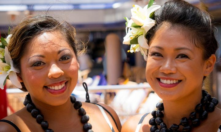 Two Polynesian women smiling