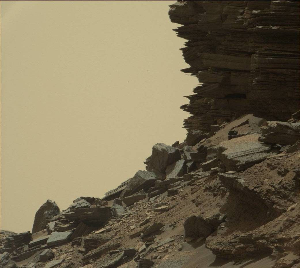 """This view from the Mast Camera (Mastcam) on NASA's Curiosity Mars rover shows a hillside outcrop with layered rocks within the """"Murray Buttes"""" region on lower Mount Sharp."""