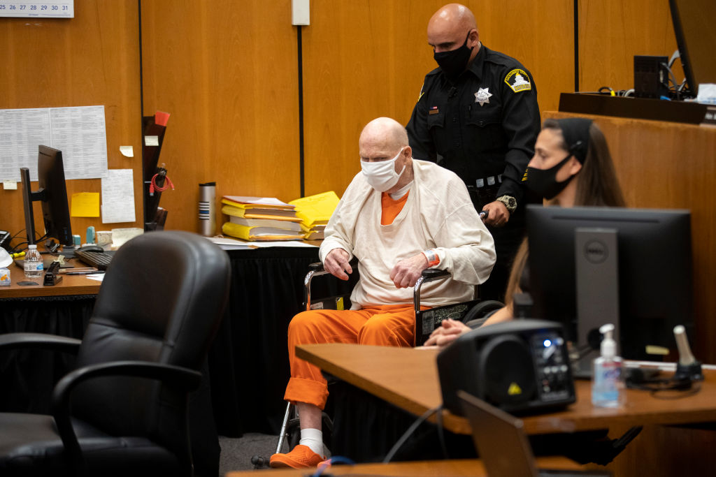 SACRAMENTO, CA - AUGUST 20: Joseph James DeAngelo in a wheelchair is brought into the courtroom for the third day of victim impact statements at the Gordon D. Schaber Sacramento County Courthouse on Thursday, Aug. 20, 2020, in Sacramento, Calif. DeAngelo, 74, admitted being the infamous Golden State Killer. He will be formally sentenced to life in prison on Friday under a plea agreement that allows DeAngelo to avoid the death sentence. The former police officer in California eluded capture for four decades. He has admitted 13 murders and nearly 50 rapes between 1975 and 1986.